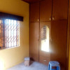 A single room self-contained apartment with a wardrobe at Gbawe